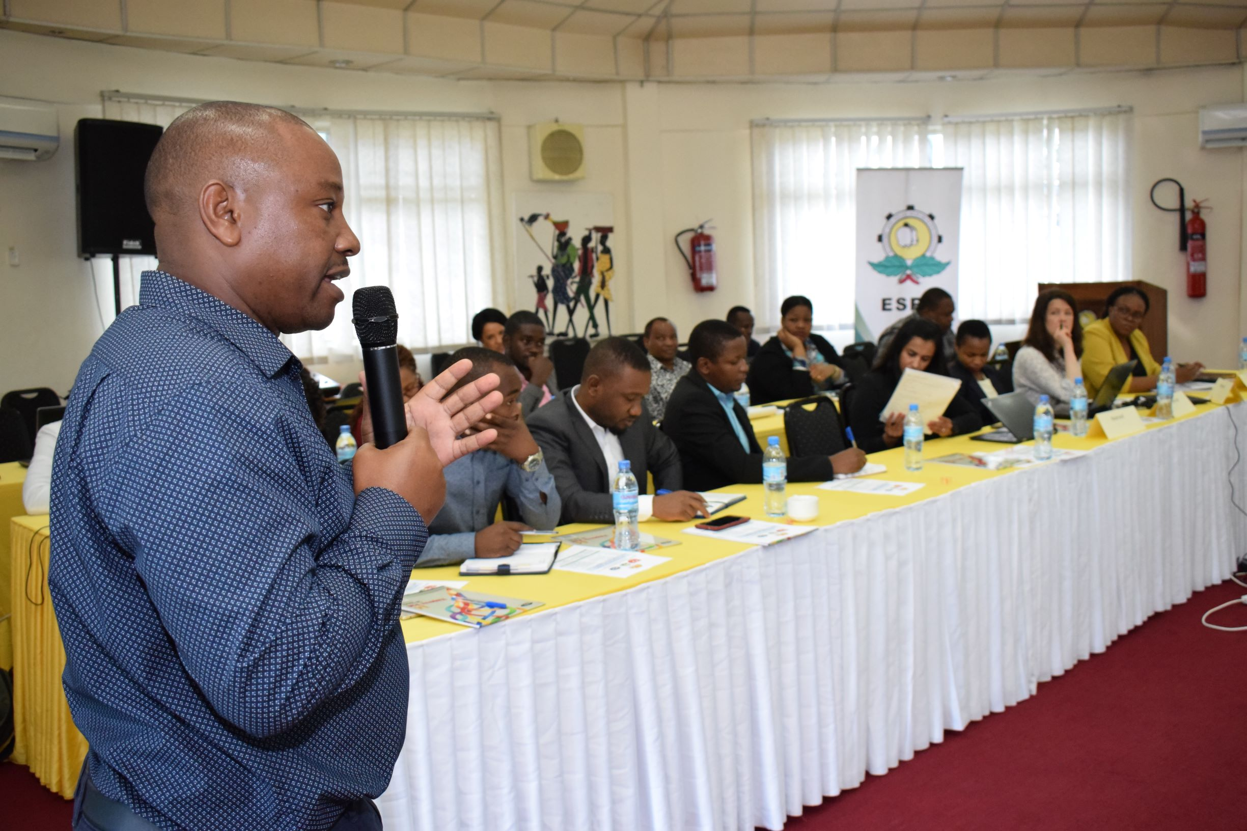 Team member Patrick Kihenzile speaks during the Maize value chain workshop on the 19th June.